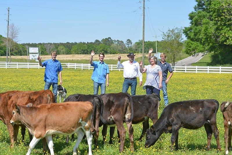 De Jong Family waving at their cows!